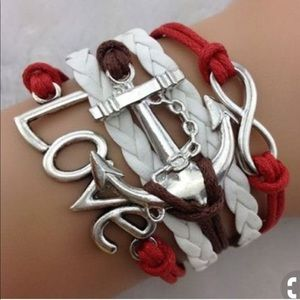 Jewelry - ⭐️Symbolic white/red/brown bracelet with charms!⭐️